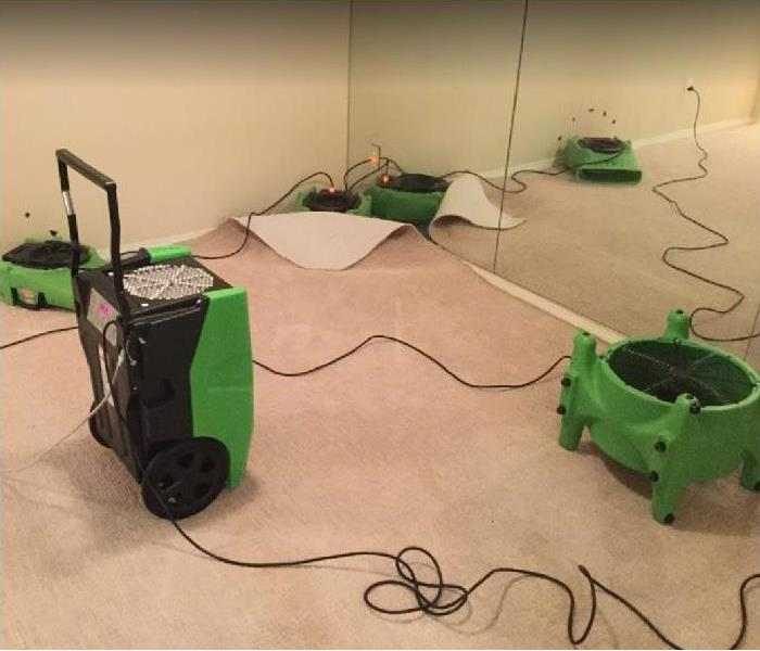 SERVPRO restoration equipment drying water damaged room
