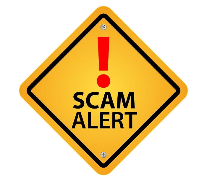 yellow warning sign with red exclamation point and SCAM ALERT