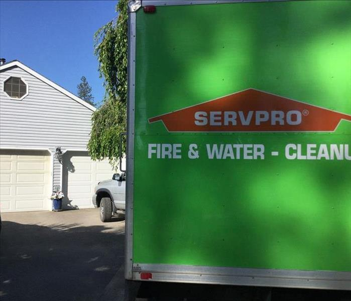 SERVPRO van parked in a driveway.