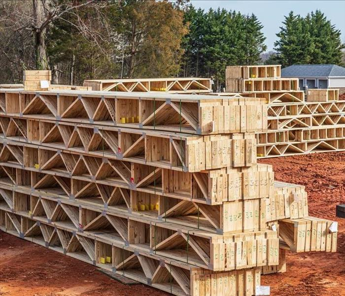 stacked trusses at a job site